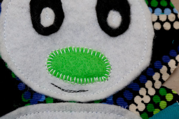 traditional applique stitching for nose on stuffed penguin