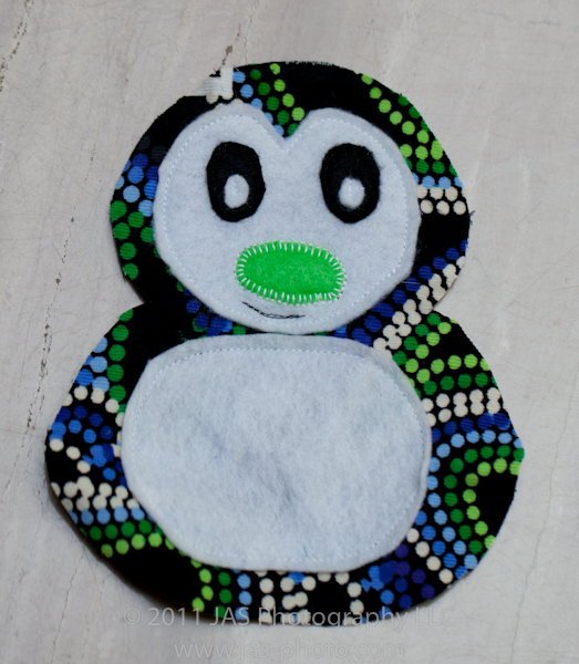 simple smile stitched on stuffed penguin face