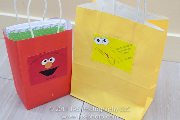 elmo party theme gift bags with elmo and big bird picture