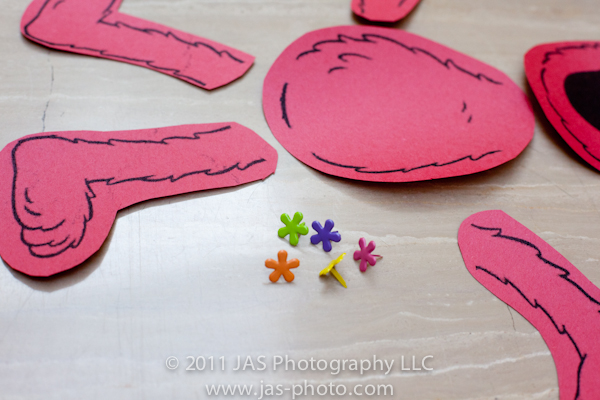 cute flower fasteners to attach limbs of build your elmo for elmo party theme activity