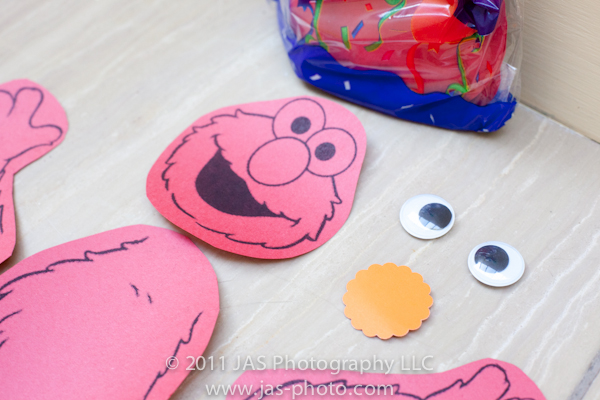googly eyes and scalloped nose for build your own elmo