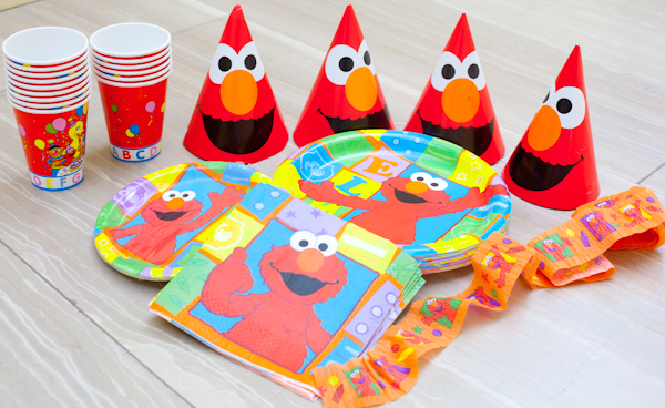 Elmo theme paper cups, plates, napkins and streamers for a sesame street elmo party
