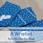 cute wristlets made with whimisical fabric as a teacher's thankyou gift with flower and ric rac embellishments